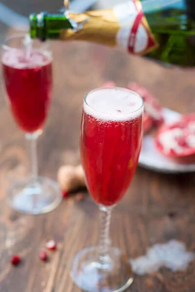 Pomegranate Champagne Cocktail from The Adventure Bite